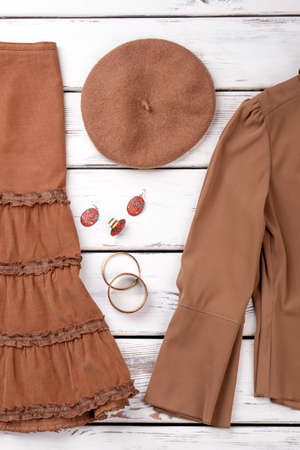 Brown autumn berete hat. Top cropped view hat and clothes. Imagens