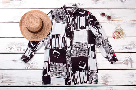 Summer clothing and accessories. Women summer short brim straw with sunglasses and braceletes.