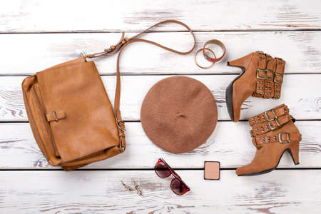 Set of brown summer womens accessories. Flat lay, top view. Clothing arrangement.