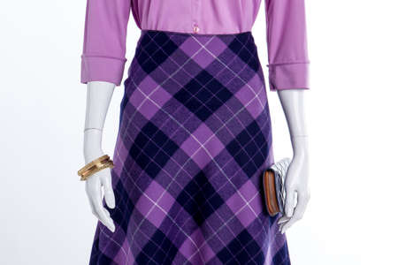 Beautiful purple womens look. Wool checkered skirt. White isolated background.