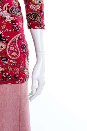 Close up mannequin hand, red stylish clothes. Cropped view. White isolated background.