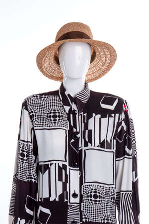 Portrain of mannequin with fancy shirt and summer hat. White isolated background.