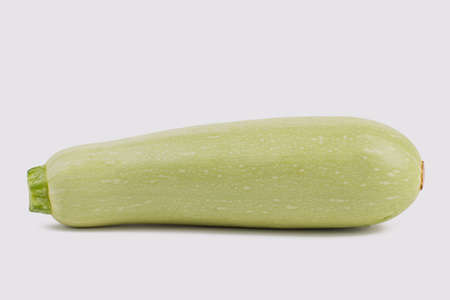 Squash vegetable marrow zucchini isolated on white background. Close up. Bright courgette.