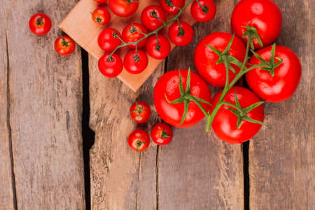 Many clean tomatos.Top view. Group of red ripe tomatoes on a wooden board.