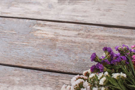 Statice limonium flowers and copyspace. Free space for text. Old wooden table.