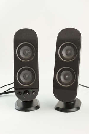 Two sound columns on white background. Pair of professional sound speakers isolated on white. Modern audio technology.