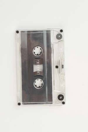Old cassette tape on white background. Retro audio cassette isolated on white, vertical image. Vintage musical technology.