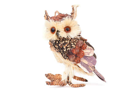 Handmade wooden owl on white background. Beautiful handicraft owl made from wood isolated on white background. Cute handmade gift.