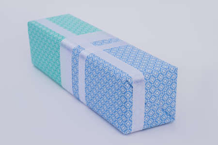 Beautiful gift box in wrapping paper. Present box for Holiday surprise. Christmas gift wrapping ideas.
