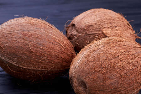 Fresh big coconuts on wooden background.