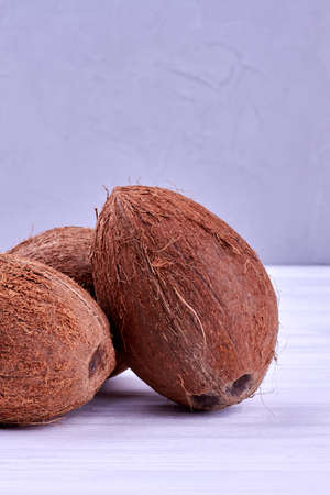 Three fresh coconuts on wooden background. 스톡 콘텐츠