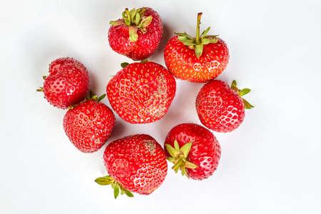 Heap of fresh strawberries on light background.
