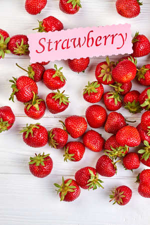 Ripe strawberries on white background, top view. 免版税图像