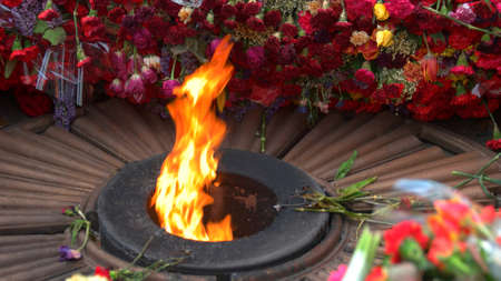 Eternal memorable fire of the Great Victory. Flowers near eternal flame. Victory in War.