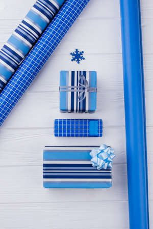 DIY gift wrapping. Preparation for winter holidays. How to wrap New Year present at home.