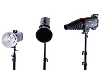 Photographic equipment isolated on white. Studio strobe flash photography lighting kit. Modern professional equipment for photographers.