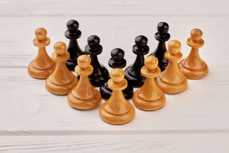 Wooden chess set on white background. Concept of strategy, teamwork and teambuilding.