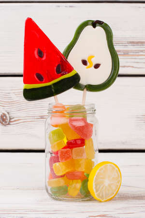 Glass jar full of candy and lollipops. Different treats and sweets in glass jar. Reklamní fotografie