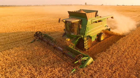 Golden field and combine harvester. How to improve country economy.