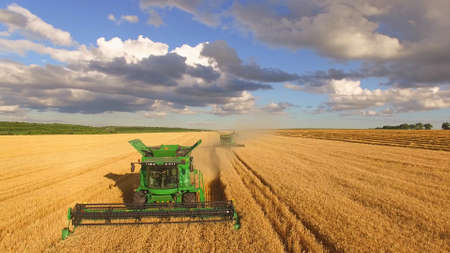 Combine harvesters and cloudy sky. Agriculture and technology. Stok Fotoğraf