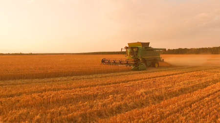 Combine harvester field and sky. Agriculture and technology.