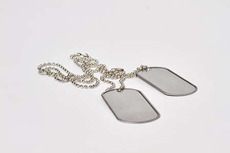 Military ID tags isolated on white background. Pair of blank metal tags on chain.