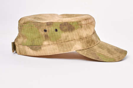 Military cap side view. White isolated background.