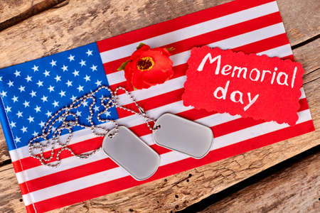 Memorial day accessories on us flag. Top view. Wooden desk background.