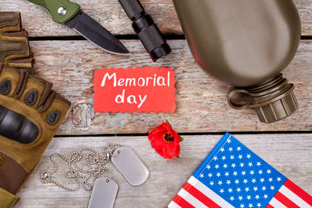 Memorial day, veterans souvenirs, top view. Wooden desk background.