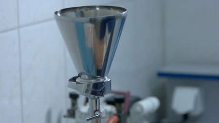 Metal equipment in chemical laboratory. Stainless steel funnel in experimental laboratory.