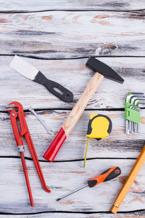 Construction tools background. A still-life of tools on a rustic wood background. Top view with copy space. Stock Photo