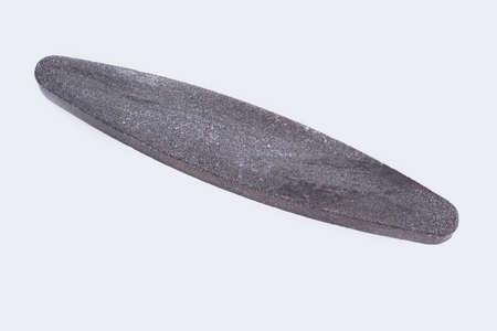 Sharpening stone on white background. Grindstone or whetstone sharpener. Kitchen utensil. Reklamní fotografie