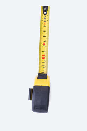 Measuring tool on white background. Yellow measuring tape, vertical image.
