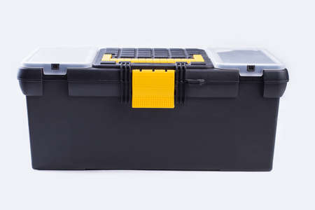 Tool box isolated on white background. Case with construction instruments, front view. Horizontal image. 免版税图像