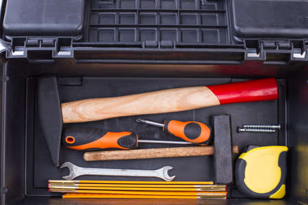 Set of building tools in black box. Tool set including hammer, screwdriver, spanners and other instruments. Stock Photo