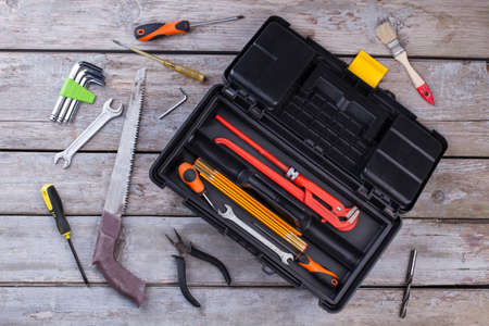Set of construction tools on wooden background. Box set of metal working tools on wooden background. Construction industry concept.