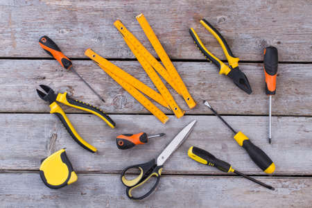 Kit of construction tools and instruments on wooden background. Set of tools for repair.