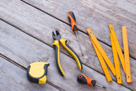 Construction tools on wooden background. Hand tools kit on wooden planks. Equipment for repairman.