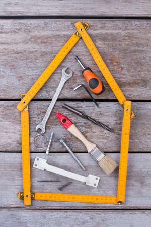 Different carpenter tools on wooden background. Composition with costruction tools on wooden boards. Repair concept.