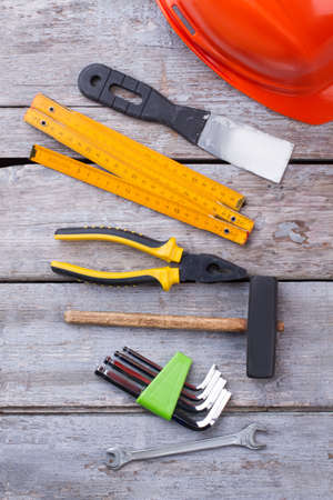 Set of hand tools on wooden background. Tool kit on wooden surface, top view. House renovation concept. Stock Photo