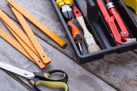 Carpenter tools on wooden background. Various construction tools for repair.