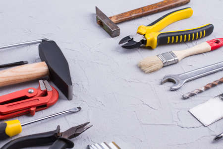 Repair carpenter tools and copy space. Set of different construction tools on gray background. Archivio Fotografico