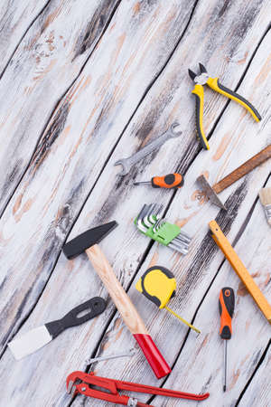 Construction tools on wood background. Flat lay working tool set and instruments for fixing. Stock Photo