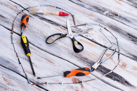 Heart shape made from construction tools. Composition with set of tools for Fathers Day. Stock Photo