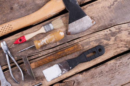 Various tools on a wooden background. Home repair and renovation concept.