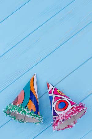 Two paper party hats, top view. Carnival theme with party hats. Kids Birthday party supplies.