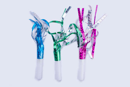 Assorted glitter fringed party whistles. Noisemakers for Birthday or New Year. Special items for party celebration.