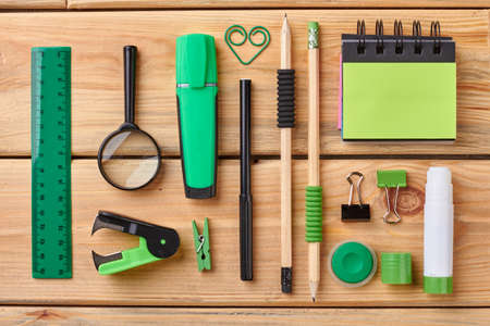 Workplace with various stationery supplies. Stationery objects on wooden background. Work and education concept. Stock Photo