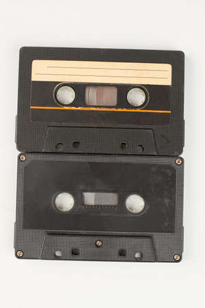 Two black audio tapes. Old cassette tapes isolated on white background. Music retro storage technology.