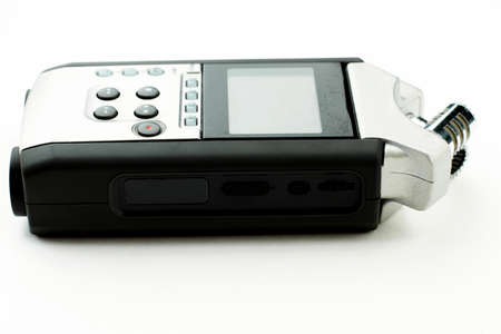 Handy recorder isolated on white background. Grey digital dictaphone, side view. Voice recording device.